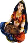 Enchanting Lady Musician Playing Mridangam